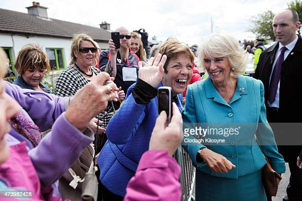 Camilla Duchess of Cornwall takes part in an impromptu walkabout outside the Claddagh Primary School on May 19 2015 in Galway Ireland The Prince of...