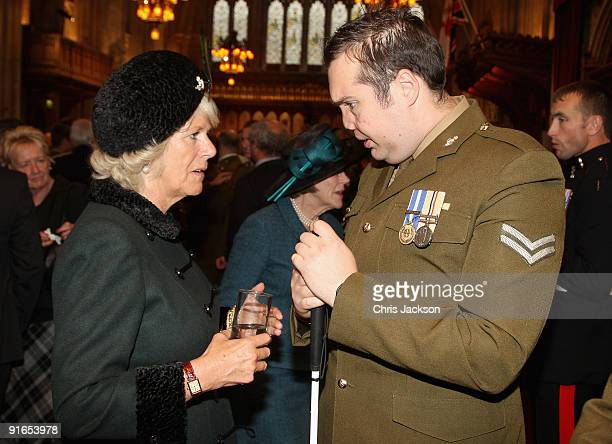Camilla, Duchess of Cornwall talks an Iraq veteran during a reception at London Guildhall after a Service of Commemoration to mark the end of combat...