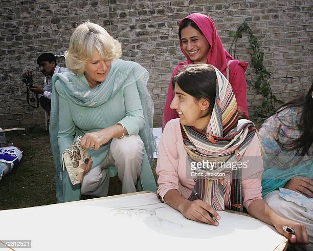 Camilla Duchess of Cornwall talks to a pupil in the art class at Fatima Jinnah college of the third day of the Royal Tour of Pakistan on October 31...