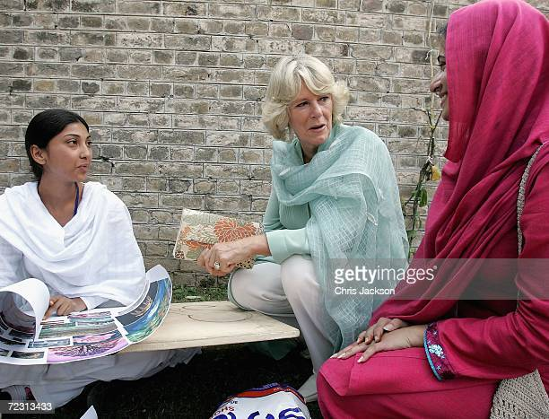 Camilla Duchess of Cornwall talks to a pupil in the art class at Fatima Jinnah college on the third day of the Royal Tour of Pakistan on October 31...