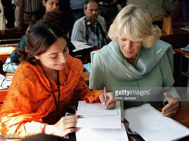 Camilla Duchess of Cornwall talks to a pupil in the class at Fatima Jinnah college of the third day of the Royal Tour of Pakistan on October 31 2006...