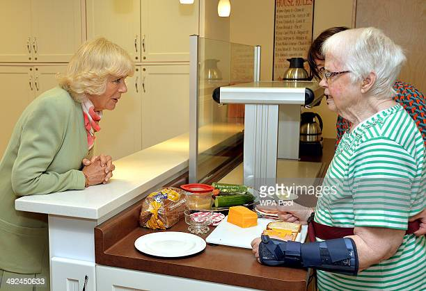 Camilla Duchess of Cornwall talks to a worker at an old peoples home on May 20 2014 in Charlottetown Canada The Prince of Wales and Duchess of...