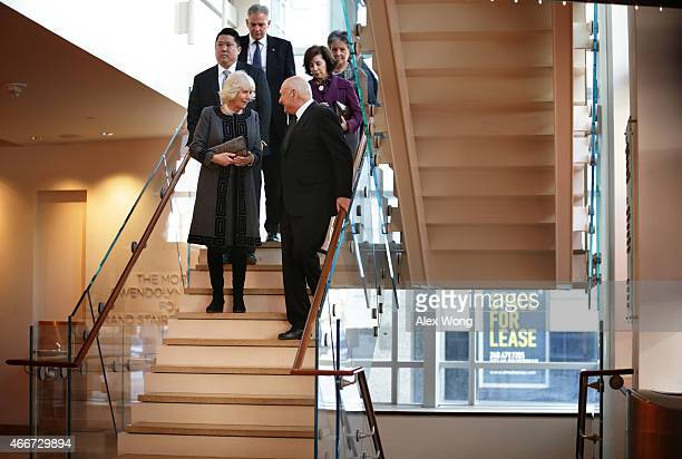Camilla Duchess of Cornwall talks to Artistic Director of the Shakespeare Theatre Company Michael Kahn as she leaves after her visit to the Company...