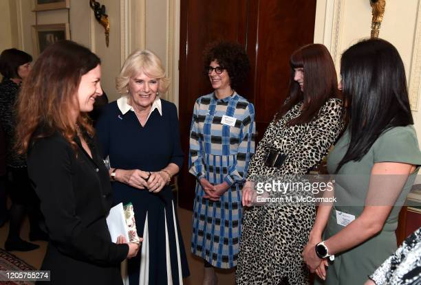 Camilla Duchess of Cornwall talks to CEO of SafeLives Suzanne Jacob SafeLives staffers Michelle Phillips Melani Morgan and Susie Hay during a...