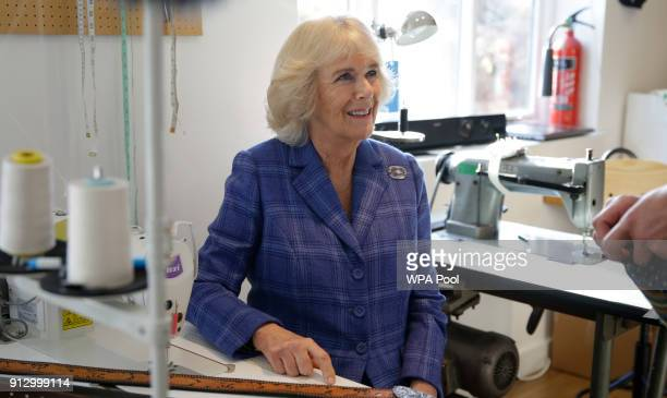 Camilla Duchess of Cornwall talks to former prisoners at the headquarters of Fine Cell Work a charity that runs rehabilitation projects in prisons on...