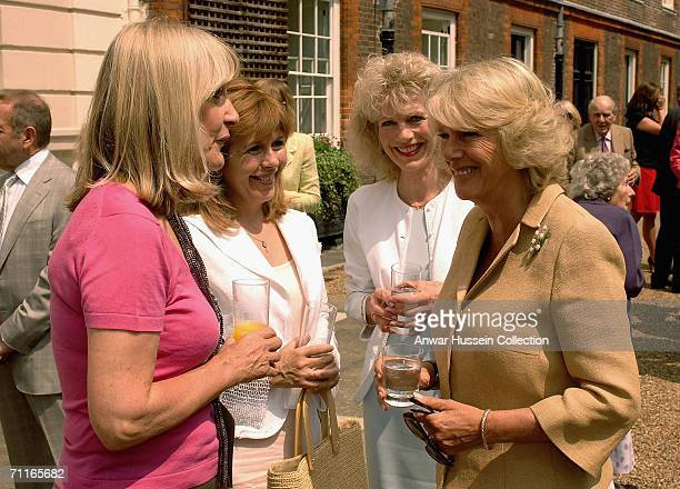 Camilla Duchess of Cornwall talks to Lynn FauldsWood Maggie Philbin and Lizzie Webb in the garden of Clarence House at a reception for the National...