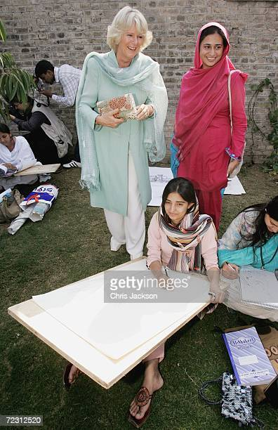 Camilla Duchess of Cornwall talks to pupils in the art class at Fatima Jinnah college of the third day of the Royal Tour of Pakistan on October 31...