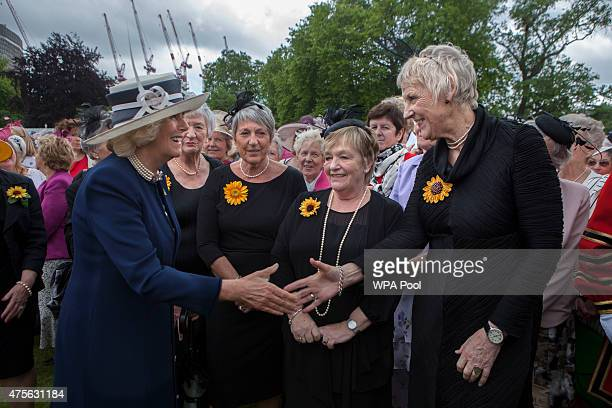 Camilla Duchess of Cornwall talks with the Calender girls Lynda Logan Angela Baker Ros Fawcett and Patricia Stewart who were made famous by a feature...