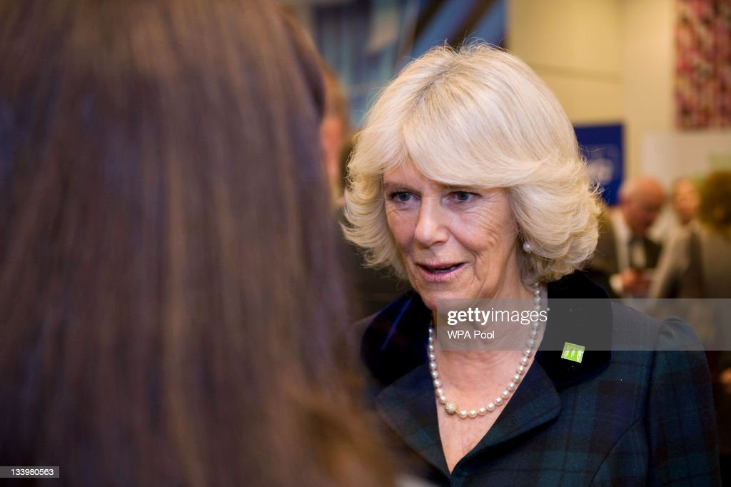 Camilla, Duchess of Cornwall, the President Barnardo's, speaks to Service user Sharon (not her real name) who told her story of abuse, as she attends 'Help Cut Children Free From Sexual Exploitation' at the KPMG building on November 23, 2011 in London England.