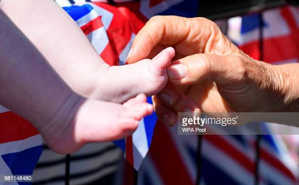 Camilla, Duchess of Cornwall, tickles a baby's feet as she greets well-wishers during the royal visit to Salisbury on June 22, 2018 in Salisbury,...
