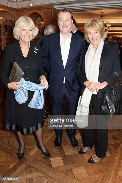 Camilla, Duchess of Cornwall, Tom Parker Bowles and Annabel Elliot attend Fortnum & Mason's Diamond Jubilee Tea Salon for the launch of Tom Parker...