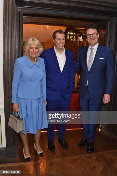 "Camilla, Duchess of Cornwall, Tom Parker Bowles and Ewan Venters attend the launch of the ""Fortnum & Mason Christmas & Other Winter Feasts"" cookbook..."