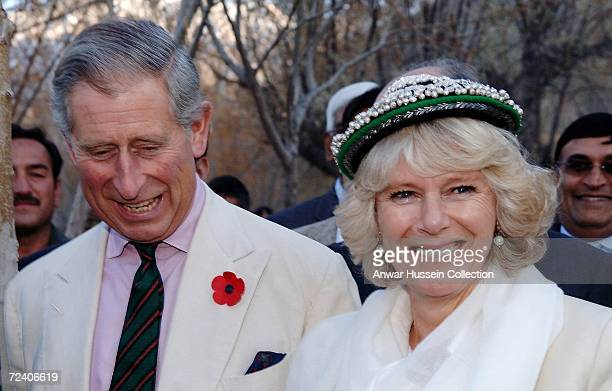 Camilla, Duchess of Cornwall, tries on a traditional Balti Nating cap, much to the amusement of her husband, Prince Charles, Prince of Wales, at...