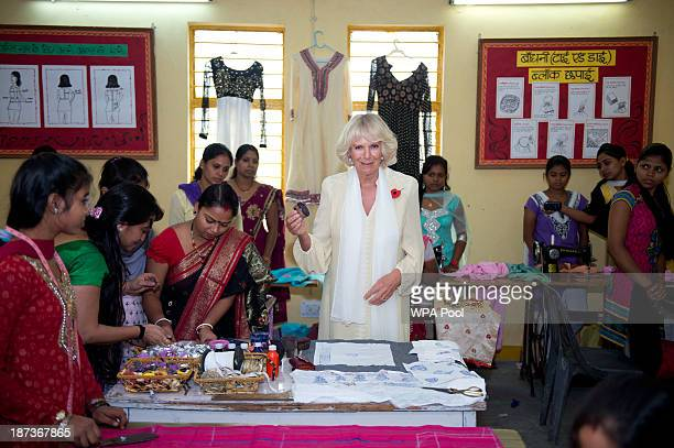 Camilla Duchess of Cornwall tries out some fabric blockprinting while visiting a school in a slum area of south Delhi during day 3 of an official...