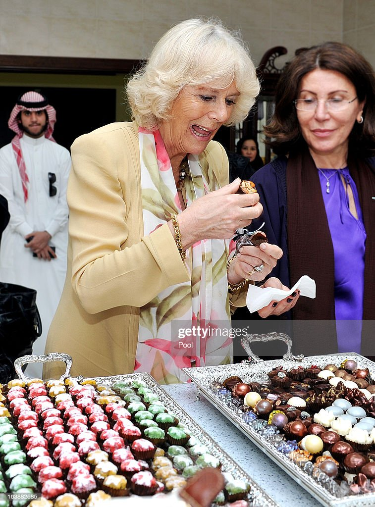 Camilla, Duchess of Cornwall tries some chocolates made by women who are learning cooking skills at the Bab Rizq Jameel Nafisa Shams Female Academy for Arts and Crafts on March 17, 2013 ,Jeddah, Saudi Arabia.