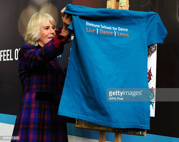 Camilla Duchess of Cornwall unveils a plaque to mark the school's 10th anniversary during a tour of Elmhurst School of Dance on November 25 2014 in...