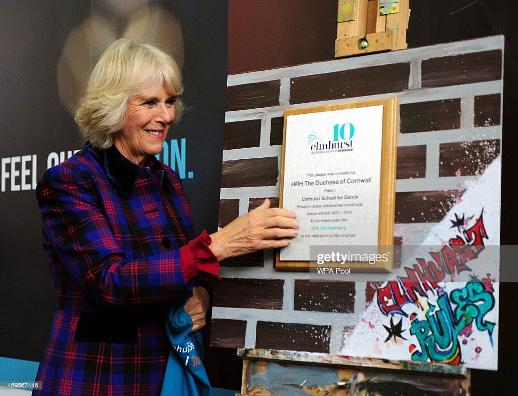 Camilla, Duchess of Cornwall unveils a plaque to mark the school's 10th anniversary during a tour of Elmhurst School of Dance on November 25, 2014 in Birmingham, England.