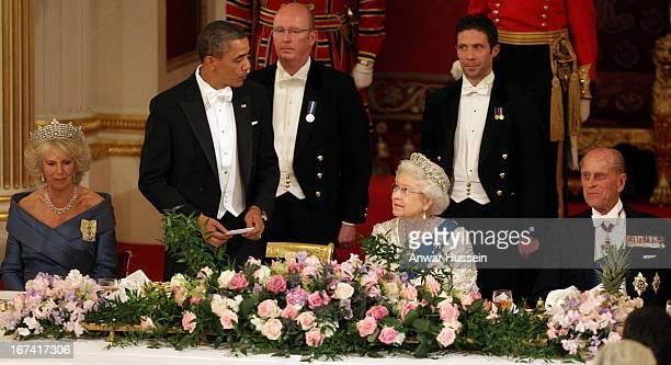 Camilla Duchess of Cornwall US President Barack Obama Queen Elizabeth II and Prince Philip Duke of Edinburhg attend a State Banquet at Buckingham...