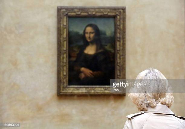 Camilla Duchess of Cornwall views Leonardo da Vinci's Mona Lisa painting as she visits the Louvre Museum on May 28 2013 in Paris France Camilla is on...