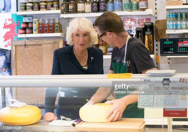 Camilla Duchess of Cornwall visits a cheese stall at Carmarthen Market where she met various stallholders during a visit to Wales on July 3 2019 in...