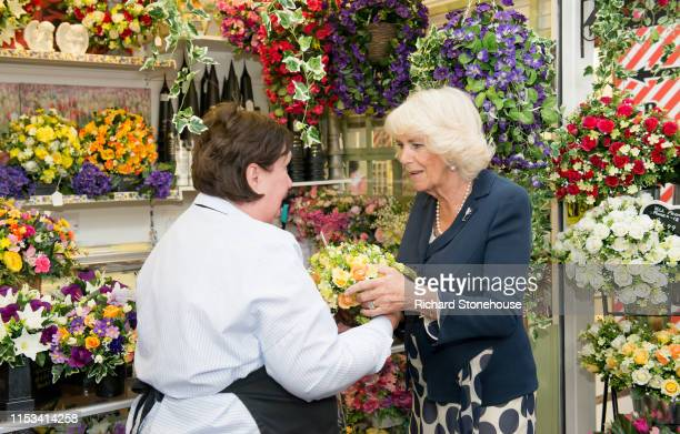 Camilla Duchess of Cornwall visits a flower stall at Carmarthen Market where she met various stallholders during a visit to Wales on July 3 2019 in...
