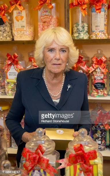 Camilla Duchess of Cornwall visits a sweet stall at Carmarthen Market where she met various stallholders during a visit to Wales on July 3 2019 in...