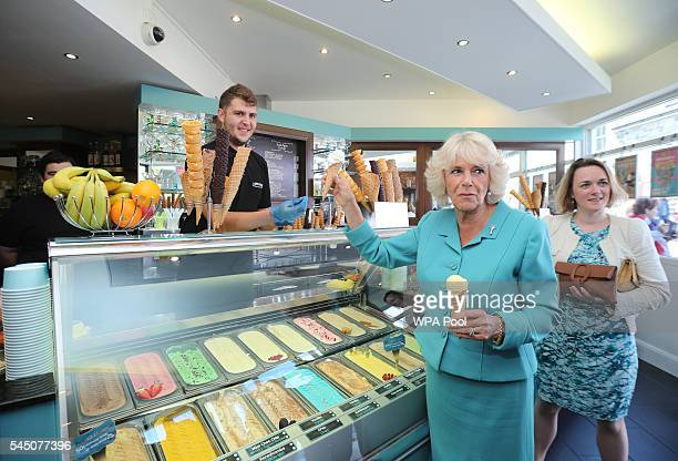 Camilla Duchess of Cornwall visits an ice cream parlour as she tours Criccieth on July 5 2016 in Gwynedd Wales The Prince Charles Prince of Wales and...