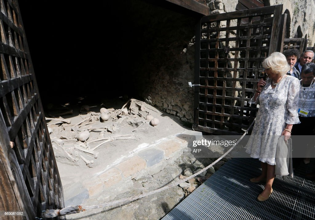 TOPSHOT - Camilla, Duchess of Cornwall visits Herculaneum Archaeological site and the Boat Pavillion in Naples, on April 1, 2017. Britain's Prince Charles and Duchess of Cornwall are doing a European tour aimed at strengthening relations with EU allies post Brexit. / AFP PHOTO / POOL / Ciro DE