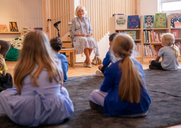 GBR: The Duchess Of Cornwall Visits Ivydale Primary School On International Literacy Day
