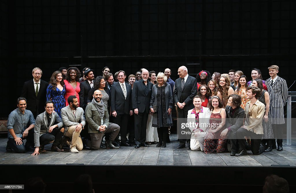 Camilla, Duchess of Cornwall visits poses with performers on stage as she visits the Shakespeare Theatre Company on the second day of a visit to the United States on March 18, 2015 in Washington, DC. The Prince and Duchess are in Washington as part of a Four day visit to the United States.