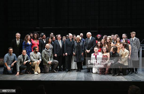 Camilla Duchess of Cornwall visits poses with performers on stage as she visits the Shakespeare Theatre Company on the second day of a visit to the...