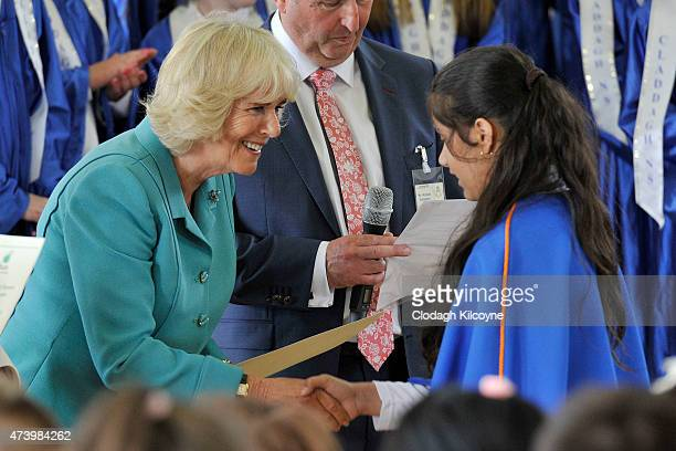Camilla Duchess of Cornwall visits the Claddagh National School where she met with and presented students with certificates recognising their...