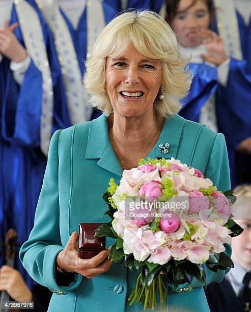 Camilla Duchess of Cornwall visits the Claddagh National School where she she was presented with a Claddagh ring and a bouquet of flowers on May 19...