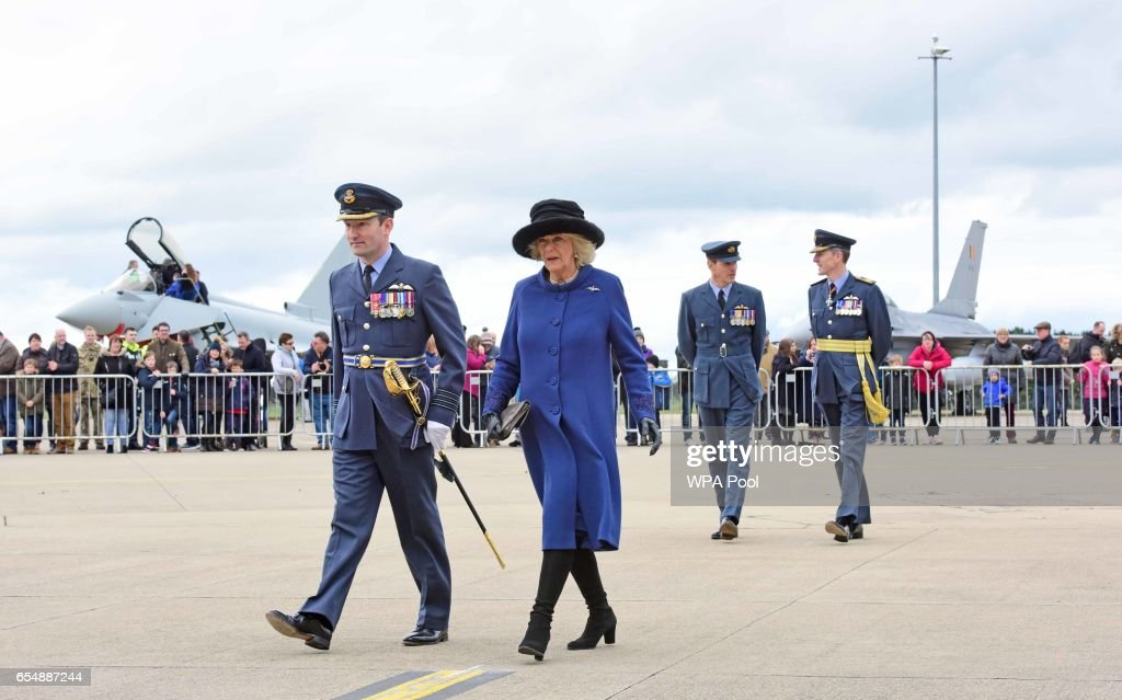 Camilla, Duchess of Cornwall walks alongside Group Captain David Arthurton, during a visit to RAF Leeming for the 100 Squadron Centenary on March 18, 2017 in Gatenby, Northallerton, England.