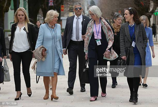 Camilla Duchess of Cornwall walks in the town center with her current biographer Penny Junor and Express reporter Camilla Tominey on March 17 2016 in...