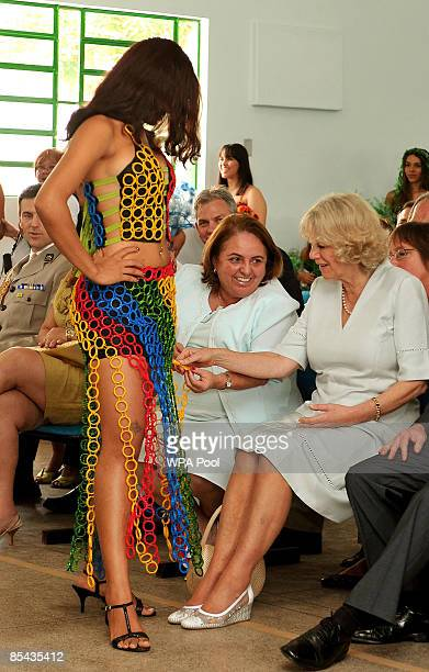 Camilla Duchess of Cornwall watches a fashion show by Brazilian models wearing outfits made from recycled rubbish on March 14 2009 in Manaus Brazil...