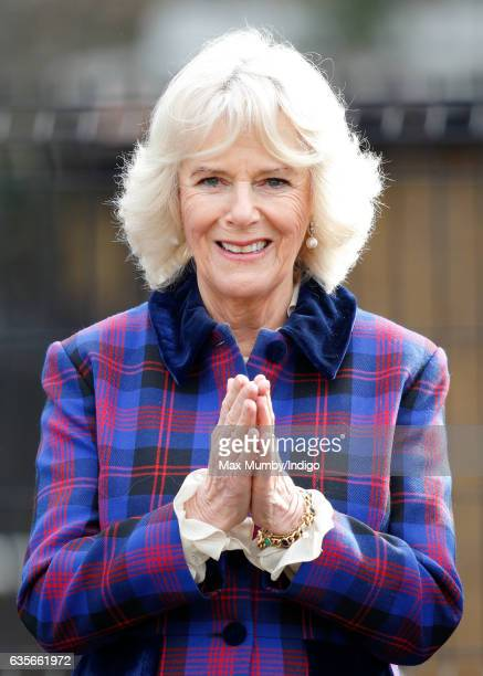 Camilla, Duchess of Cornwall watches a horse riding display during a visit to the Ebony Horse Club riding centre to celebrate the club's 21st...