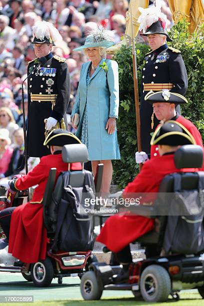 Camilla, Duchess of Cornwall watches a march past of Chelsea Pensioners as she visits the Royal Hospital Chelsea to review The Founder's Day Parade...