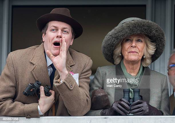 Camilla Duchess of Cornwall watches a race from the temporary Royal Box with her son Tom Parker Bowles on the second day of the Cheltenham Festival...