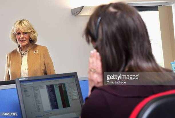 Camilla Duchess of Cornwall watches Helpline staff at work at the National Osteoporosis Society Headquarters on February 5 2009 in Bath England The...