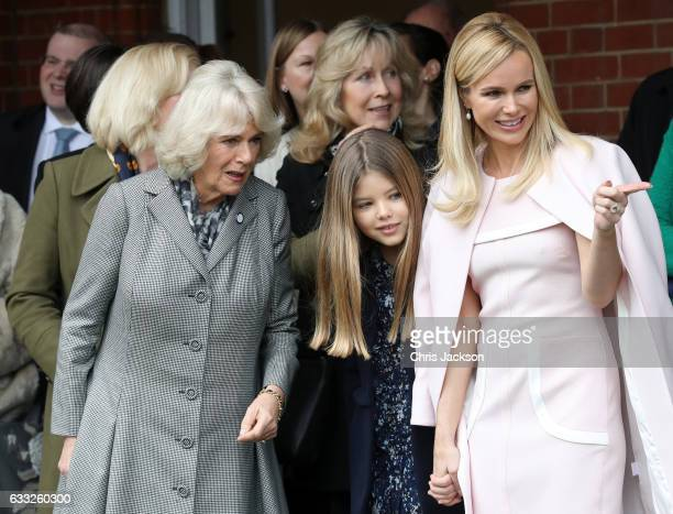 Camilla Duchess Of Cornwall watches her dog Beth compete an agility course with Amanda Holden and her daughter Alexa Hughes during her visit to...