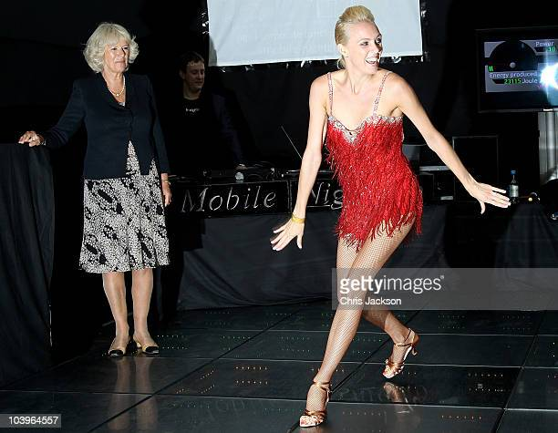 Camilla, Duchess of Cornwall watches Ian Waite and Camilla Dallerup dance on a mobile dance floor powered by foot movement during a visit to 'The...