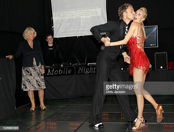 Camilla Duchess of Cornwall watches Ian Waite and Camilla Dallerup dance on a mobile dance floor powered by foot movement during a visit to 'The...