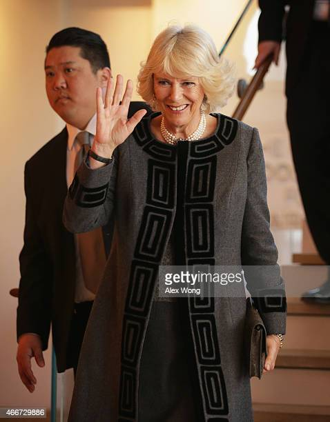 Camilla Duchess of Cornwall waves as she leaves after her visit to the Shakespeare Theatre Company March 18 2015 in Washington DC The Duchess of...