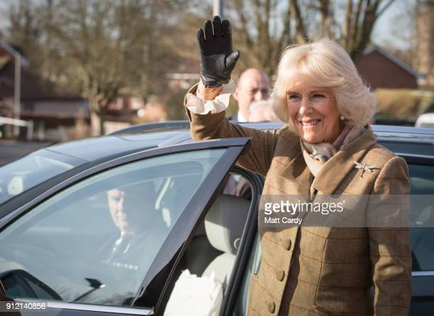 Camilla Duchess of Cornwall waves goodbye to school pupils as she leaves following a visit to Marlborough St Mary's Church of England Primary School...