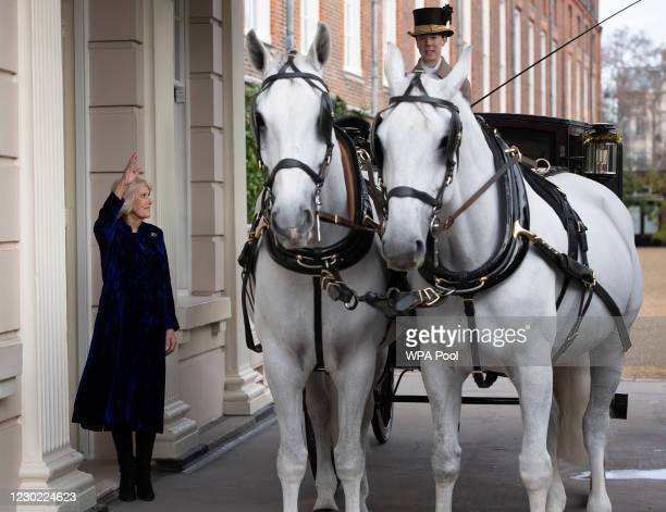 Camilla, Duchess of Cornwall waves off The Royal Brougham accompanied by Captain Charles Ross Assistant Equerry as the Duchess of Cornwall decorates...
