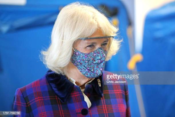 Camilla, Duchess of Cornwall wearing a face-mask and protective glasses during a visit to Gloucestershire Vaccination Centre at Gloucestershire Royal...