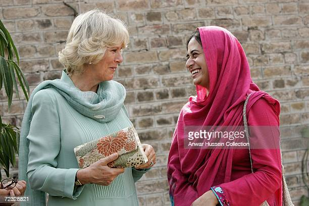 Camilla Duchess of Cornwall wearing a traditional Shalwar Kameez chats with a student at the all female Fatima Jinnah University on the third day of...