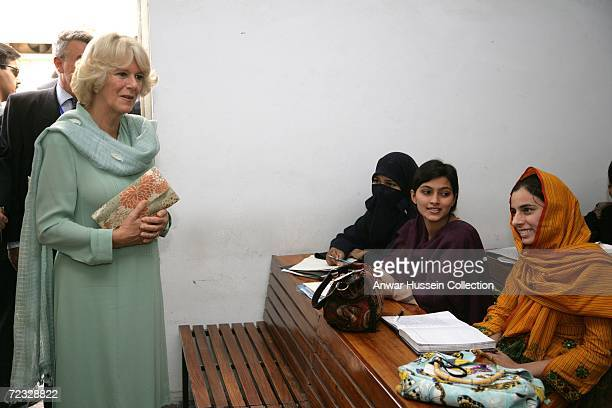 Camilla Duchess of Cornwall wearing a traditional Shalwar Kameez visits an Islamic study class at the all female Fatima Jinnah University on the...