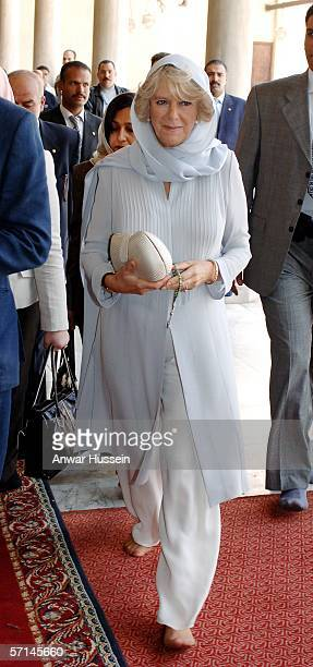 Camilla Duchess of Cornwall wearing a traditional Shalwar Kameez and headscarf and walking with bare feet visits the Al Azhar mosque with Prince...